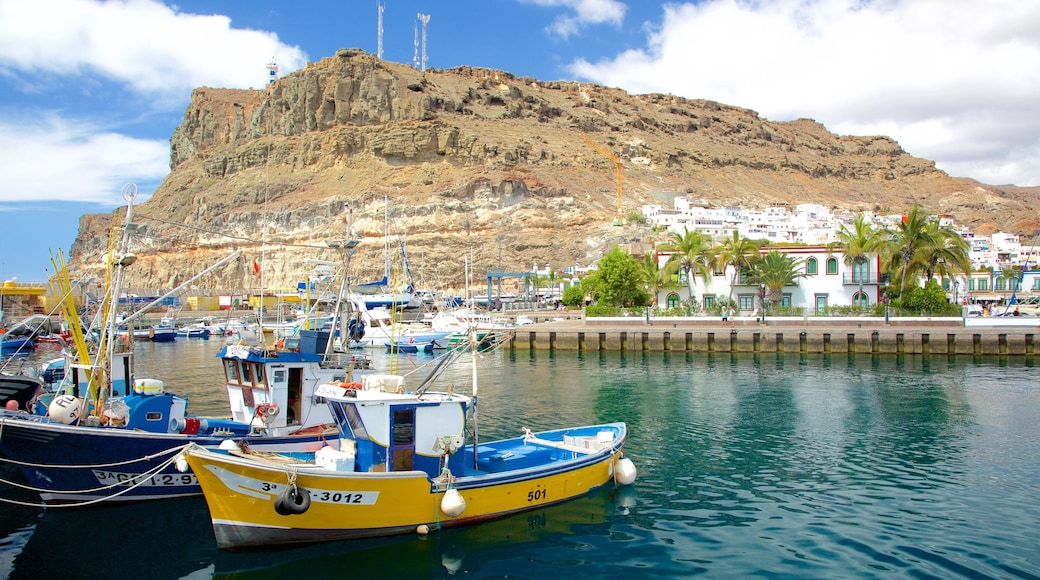 Puerto de Mogan featuring a coastal town, a bay or harbour and boating
