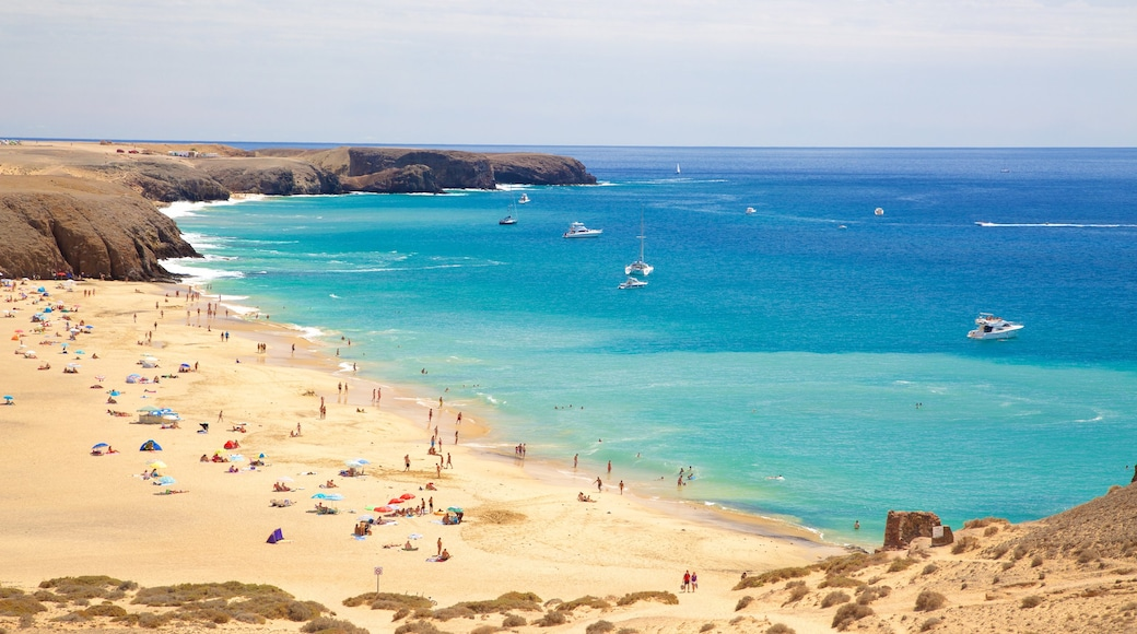 Papagayo Beach which includes general coastal views, a sandy beach and boating