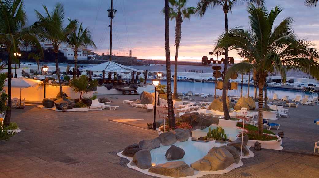 Puerto de la Cruz featuring a pool, a sunset and a luxury hotel or resort
