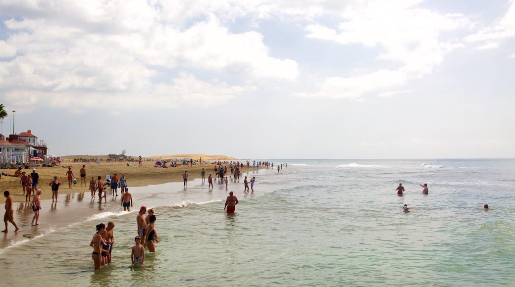 Meloneras mit einem allgemeine Küstenansicht, Sandstrand und Schwimmen