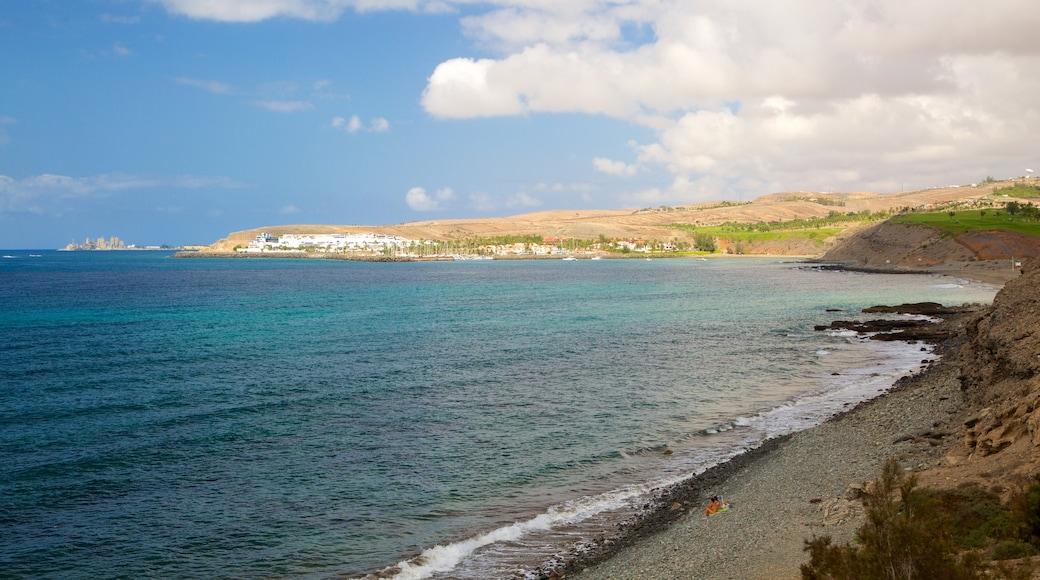 Strand von Meloneras welches beinhaltet allgemeine Küstenansicht und Steinstrand