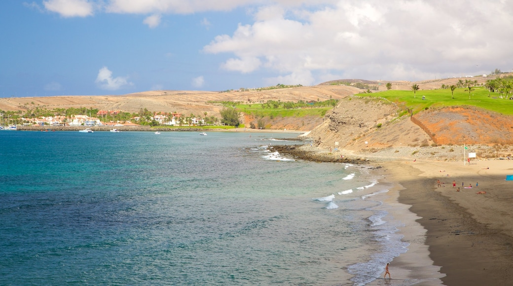 Strand von Meloneras mit einem Sandstrand und allgemeine Küstenansicht