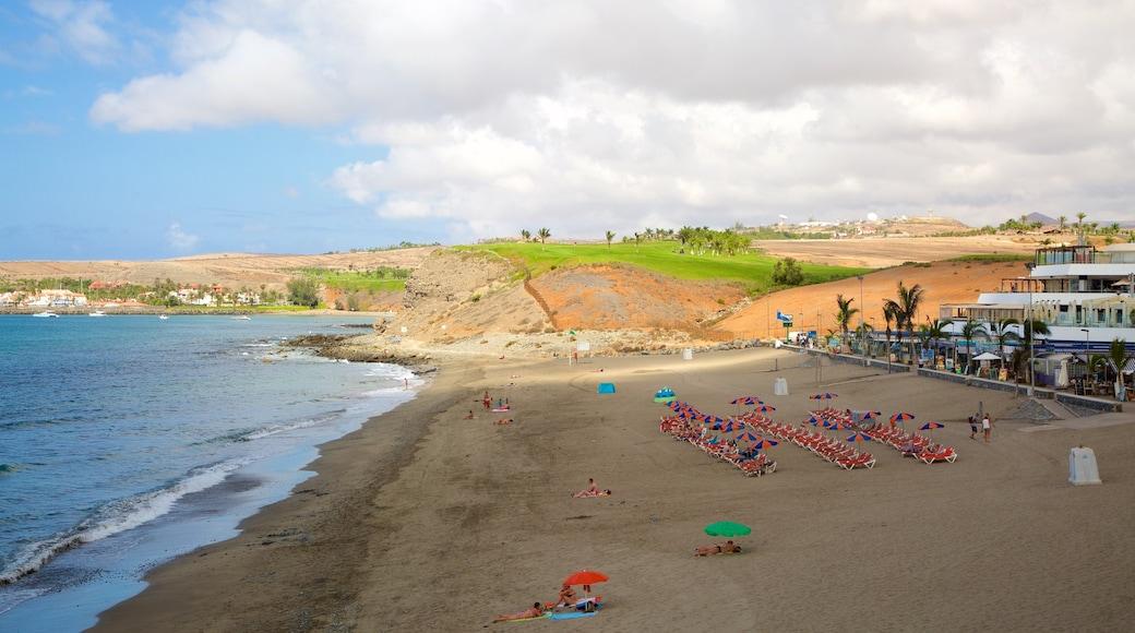 Playa Meloneras ofreciendo vistas de una costa y una playa de arena