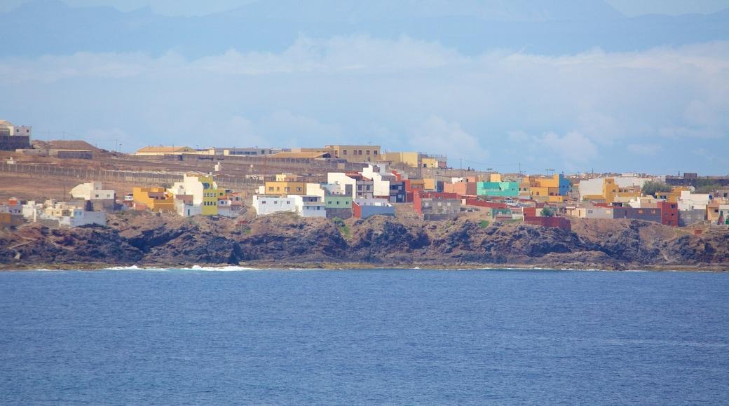 Gran Canaria which includes general coastal views, a coastal town and rugged coastline