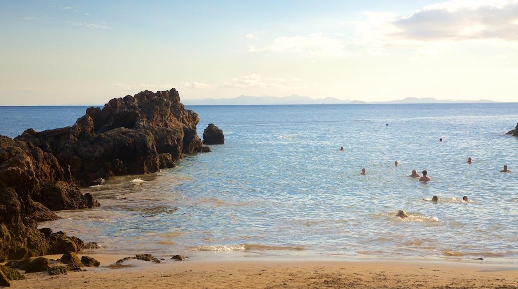 Puerto del Carmen montrant vues littorales, ville côtière et baignade