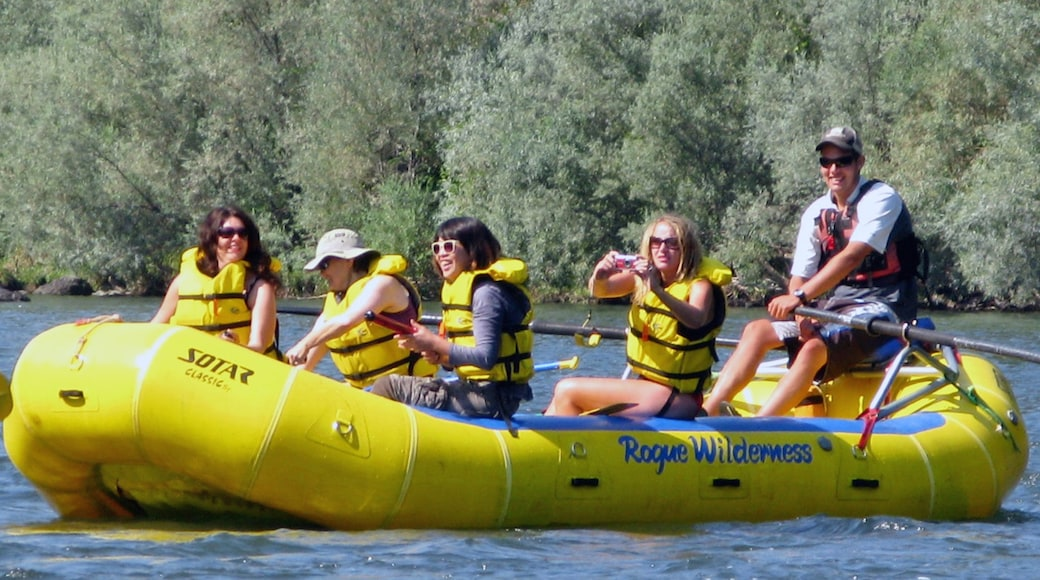 Rogue River featuring rafting and a river or creek as well as a small group of people