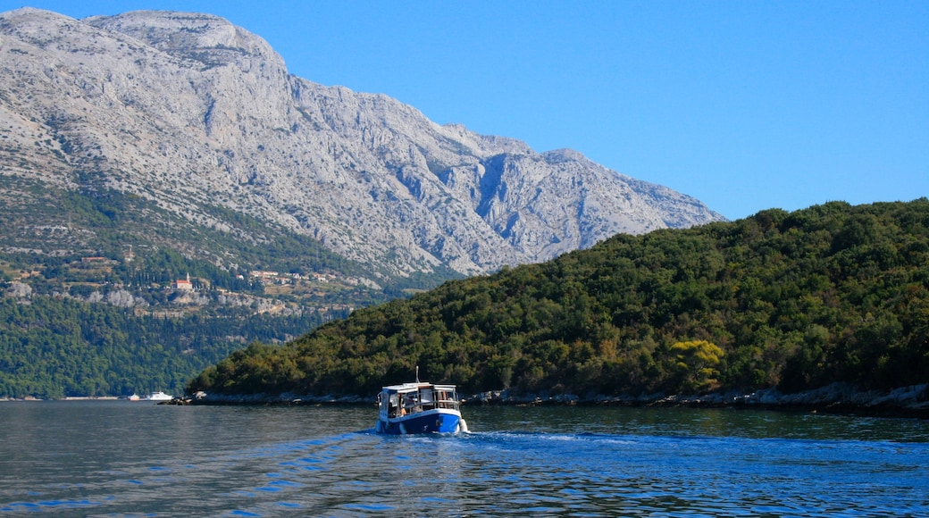 Croatia which includes boating, mountains and a lake or waterhole