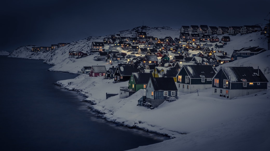 Nuuk featuring mountains, snow and night scenes