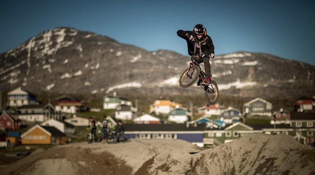Nuuk showing a city, mountain biking and mountains