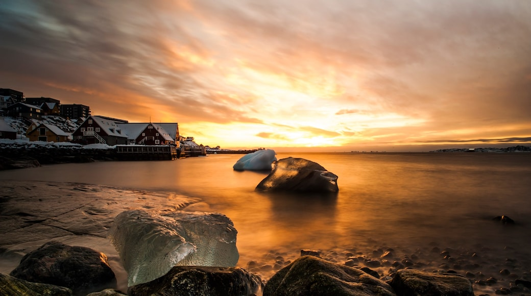 Nuuk featuring a house, a sunset and general coastal views