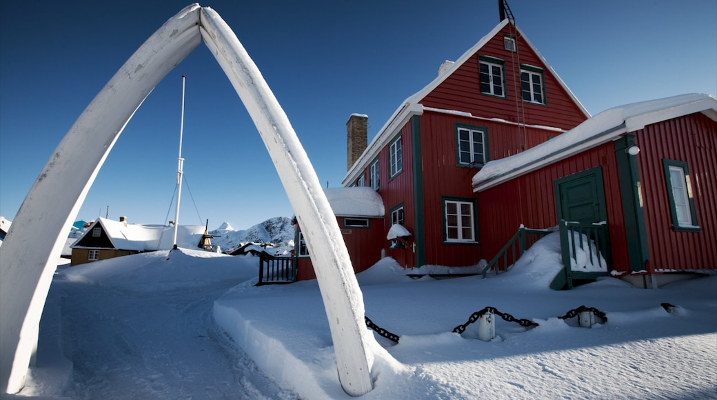 Sisimiut featuring snow and a house