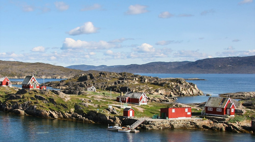 Sisimiut featuring mountains and a small town or village