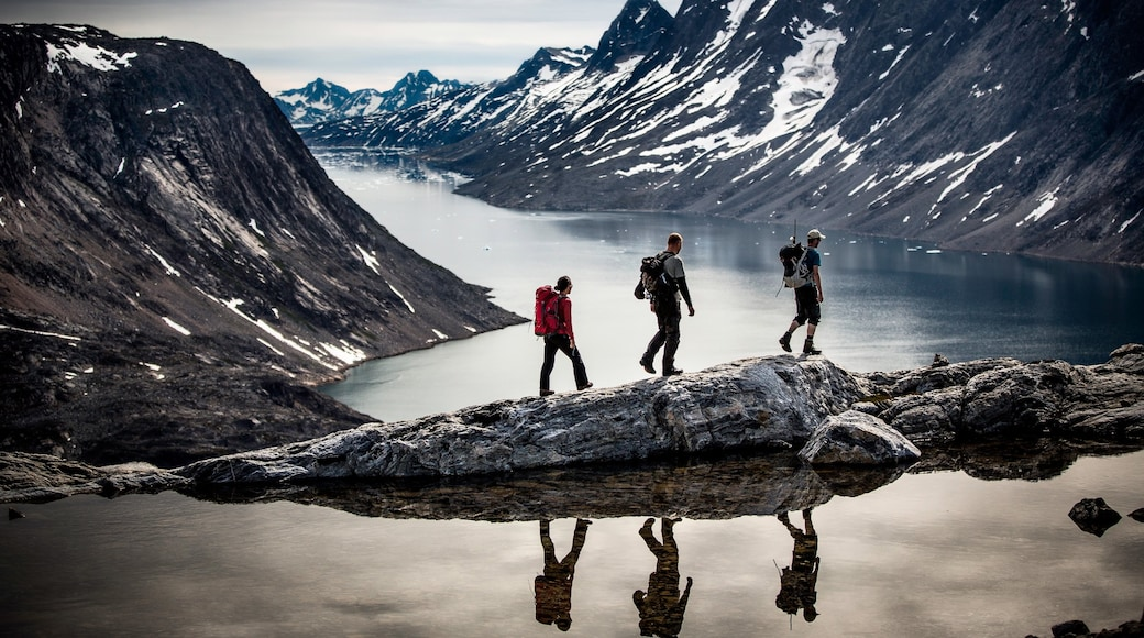 Greenland featuring hiking or walking, a lake or waterhole and snow