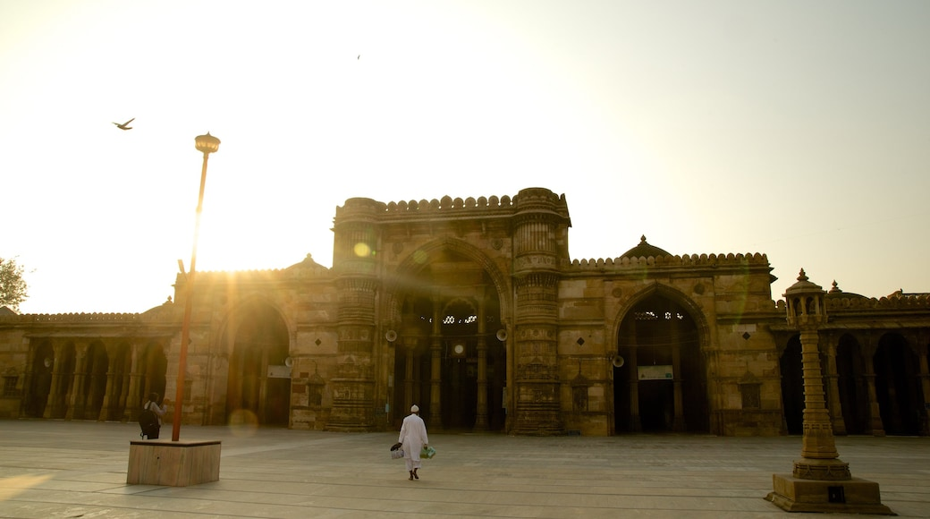Jama Masjid Mosque featuring heritage architecture and a sunset
