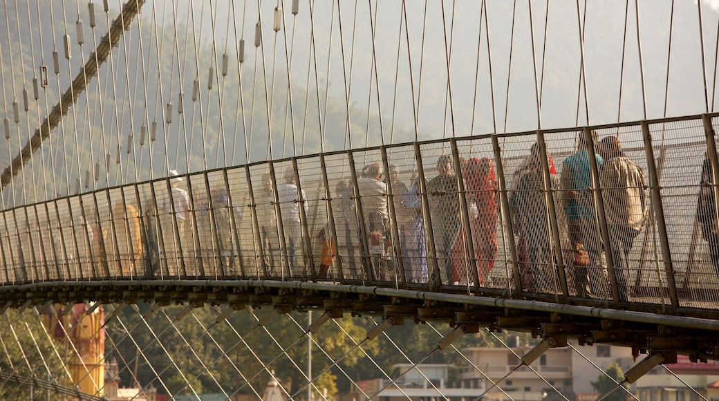 Ram Jhula which includes a suspension bridge or treetop walkway as well as a small group of people