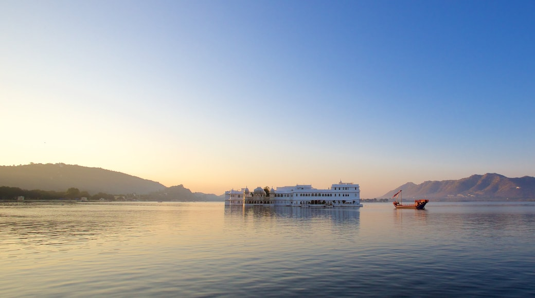 Lake Palace which includes island views, a sunset and a lake or waterhole