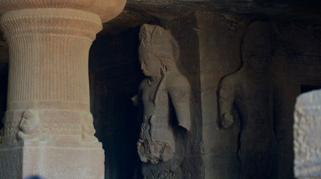 Elephanta Caves showing caves, a statue or sculpture and heritage elements