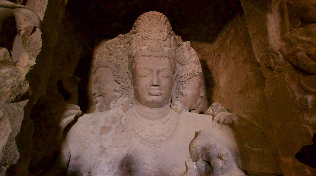 Elephanta Caves featuring a statue or sculpture and heritage elements