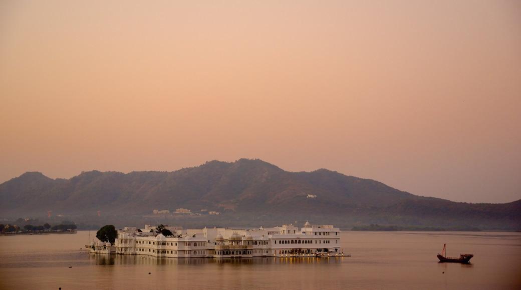 Lake Palace showing a lake or waterhole, island views and a sunset