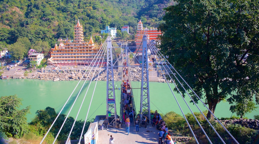 Lakshman Jhula which includes a river or creek, a suspension bridge or treetop walkway and a small town or village