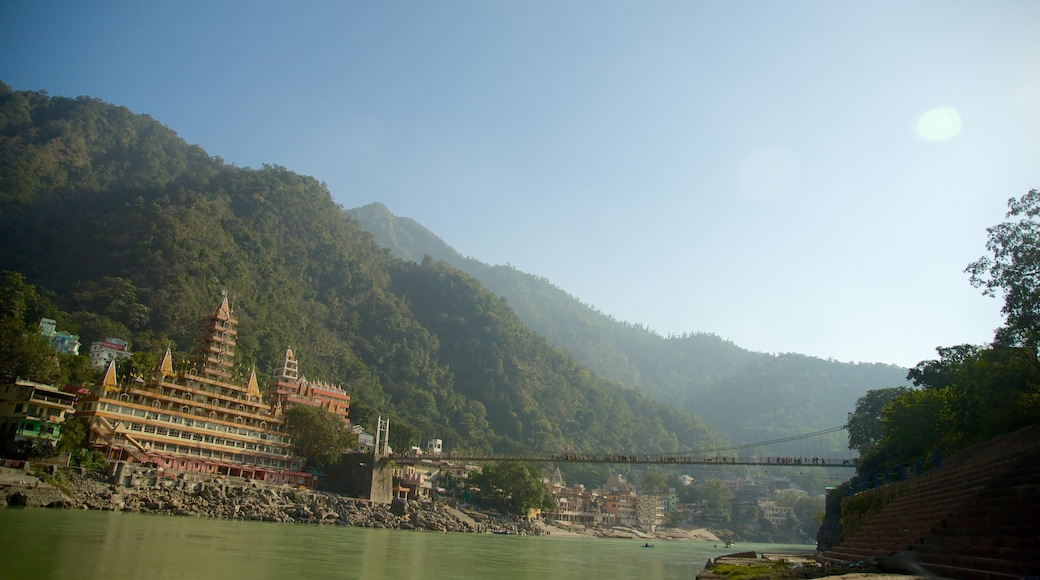 Lakshman Jhula featuring a river or creek and a small town or village