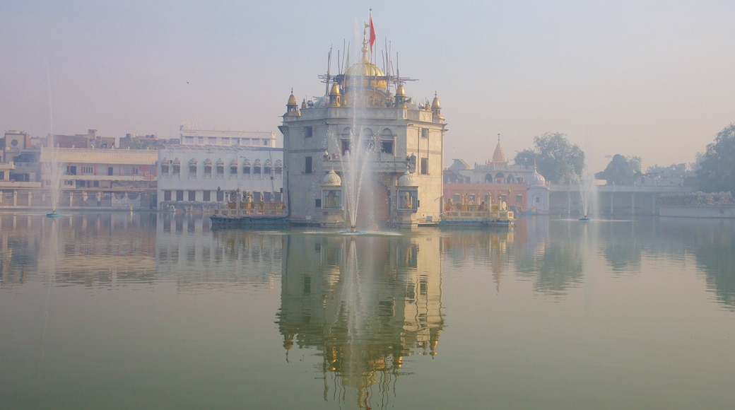 Durgiana Temple showing heritage elements, a lake or waterhole and a temple or place of worship