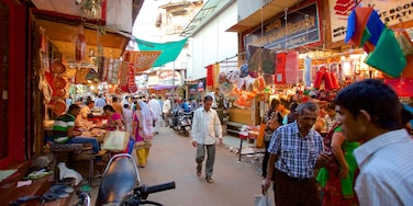Manek Chowk featuring markets as well as a small group of people