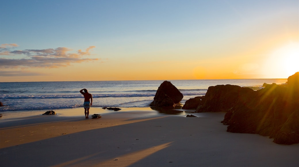 Byron Bay which includes general coastal views, a beach and a sunset