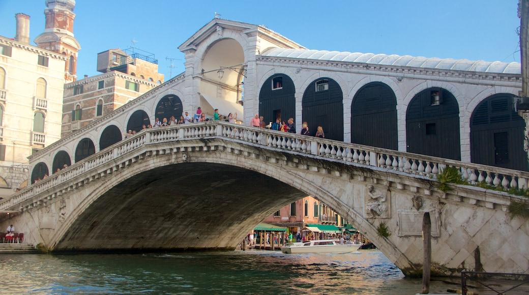 Rialto Bridge which includes heritage architecture, a bridge and a lake or waterhole