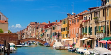 Venetian Ghetto which includes boating, a coastal town and heritage architecture