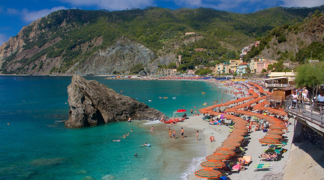 Monterosso Beach which includes rocky coastline, swimming and a luxury hotel or resort