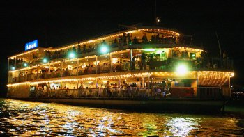 Saigon River Dinner Cruise with Water Puppet Show & Cyclo Tour