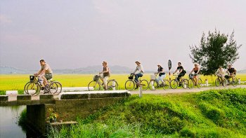 Private Full-Day Hue Bike Tour with Perfume River Boat Ride