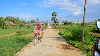 Private Full-Day Cycling Tour to Thanh Ha Pottery Village & Tra Que