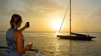 Sunset Catamaran Cruise with Live Caribbean Music & Drinks
