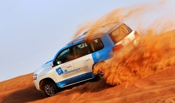 Abu Dhabi: Desert Safari with BBQ, Camel Ride & Sandboarding