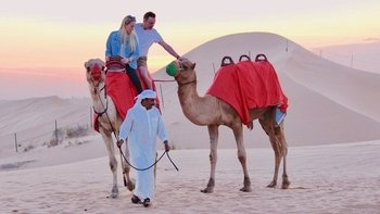 Camel Trekking In the Serene Desert Of Arabia