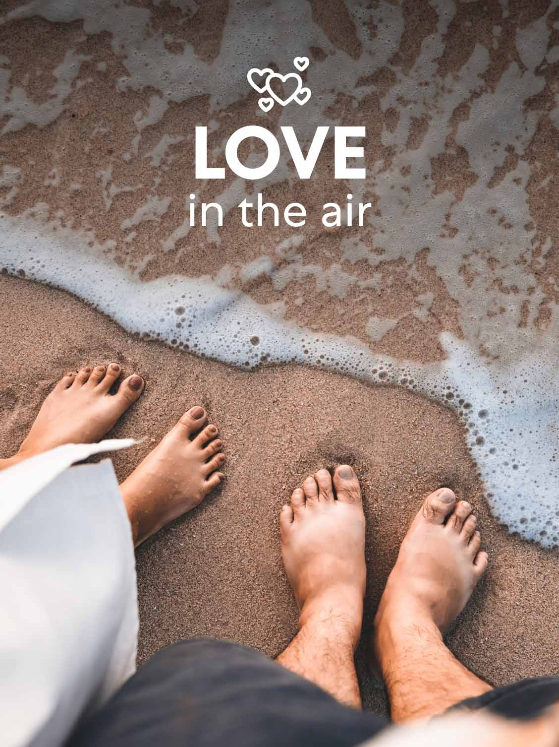 Point a view of a man and woman looking down at their feet in the sand, just at the water's edge. A superimposed title reads: Love in the air