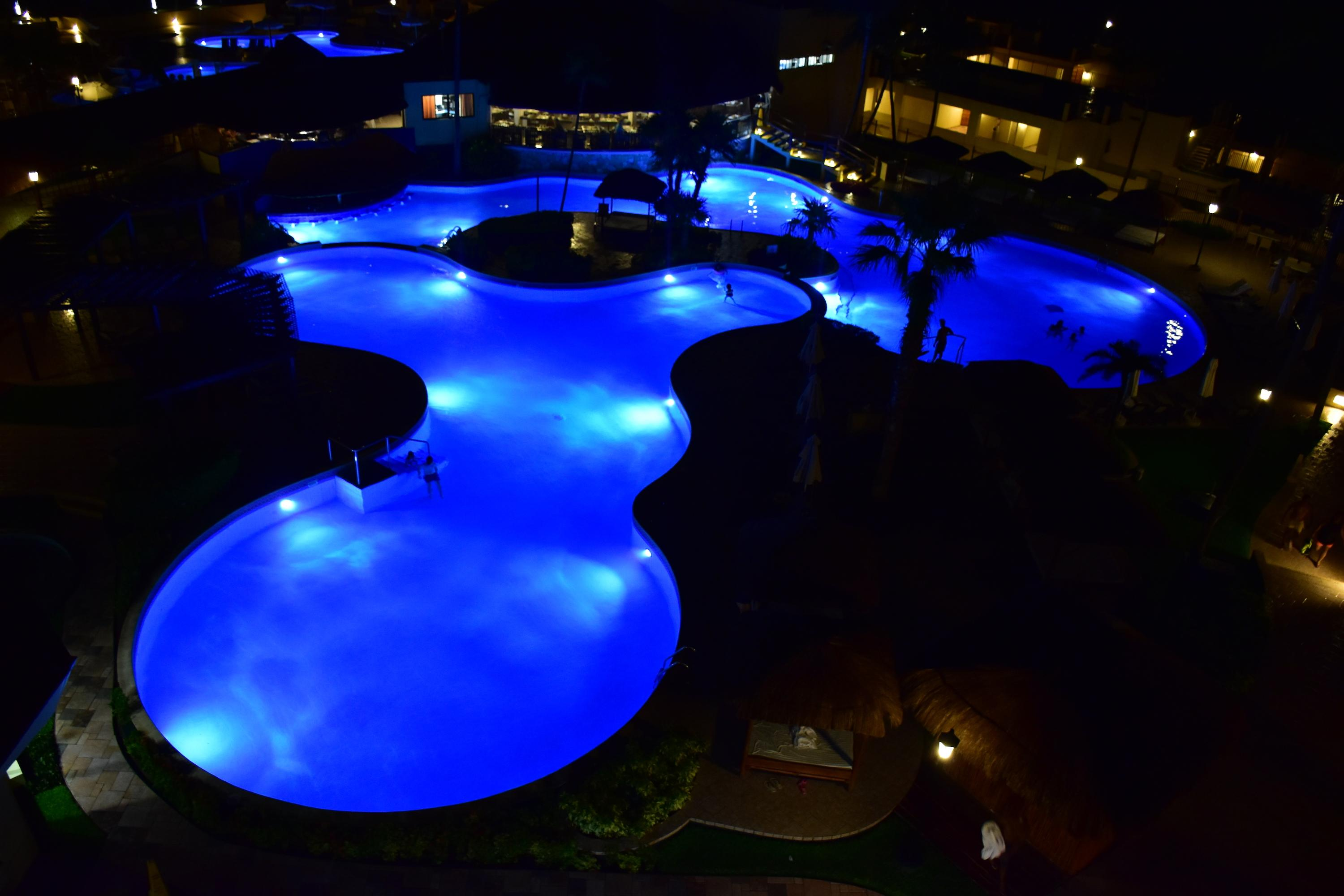 Pool view at night from balcony