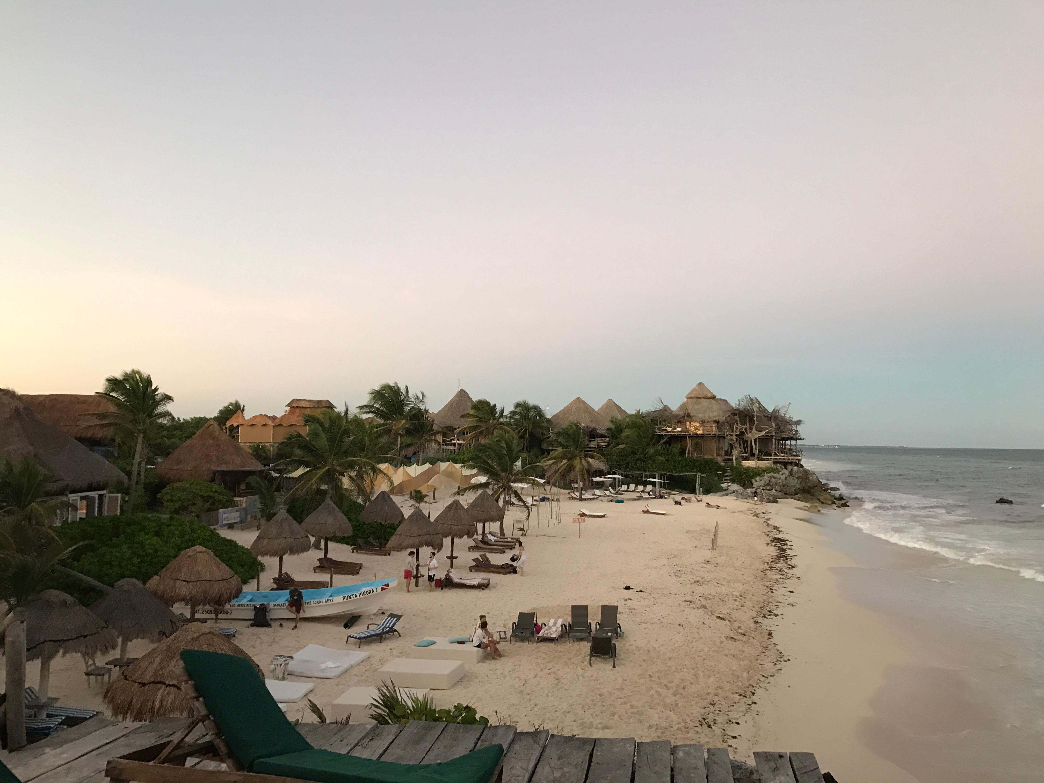 Pic is of stretch of beach. Hotel in front of tiki beach chairs