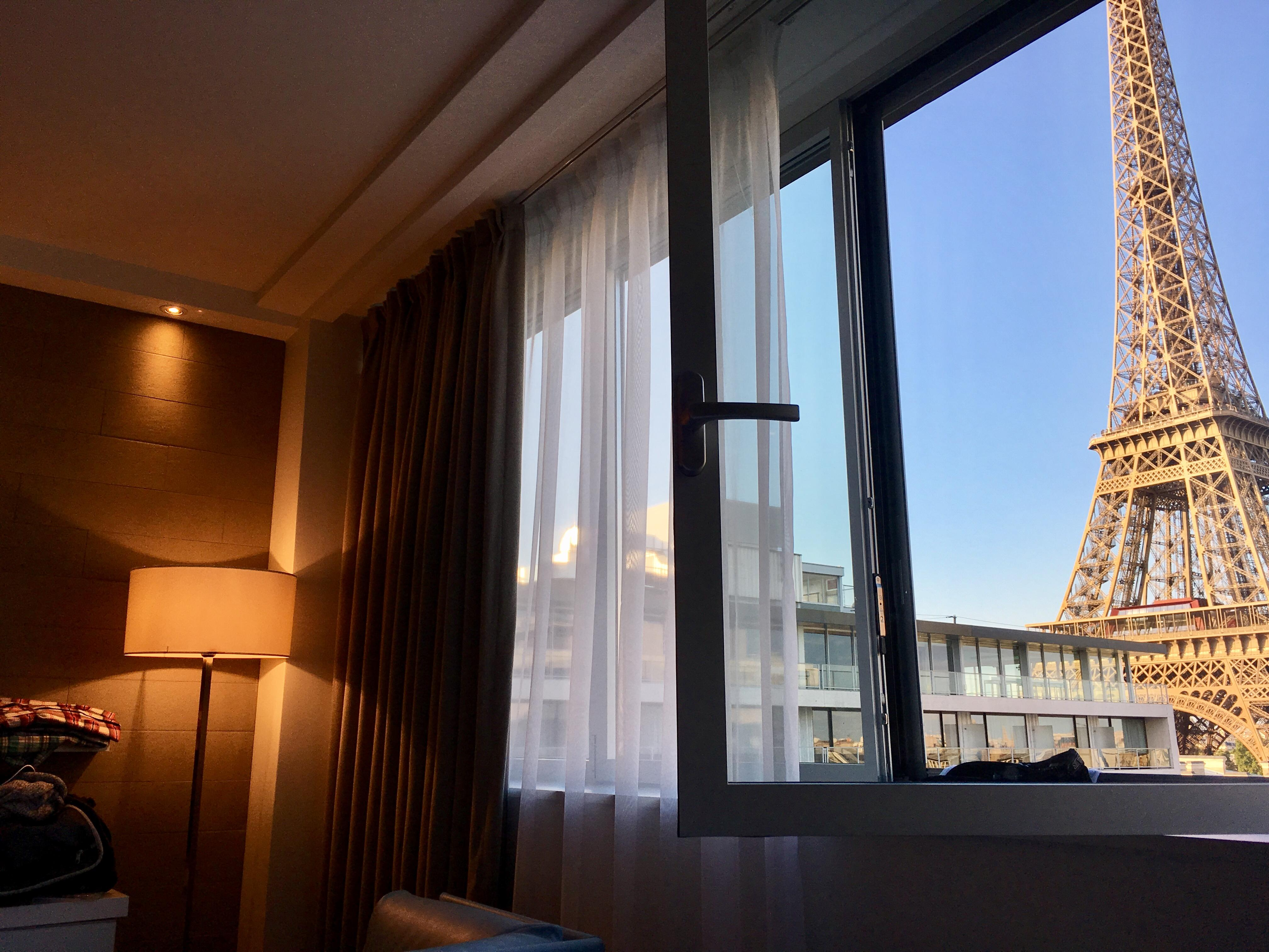 The Eiffel Tower is literally one block over and this is the view while lying on the bed !!