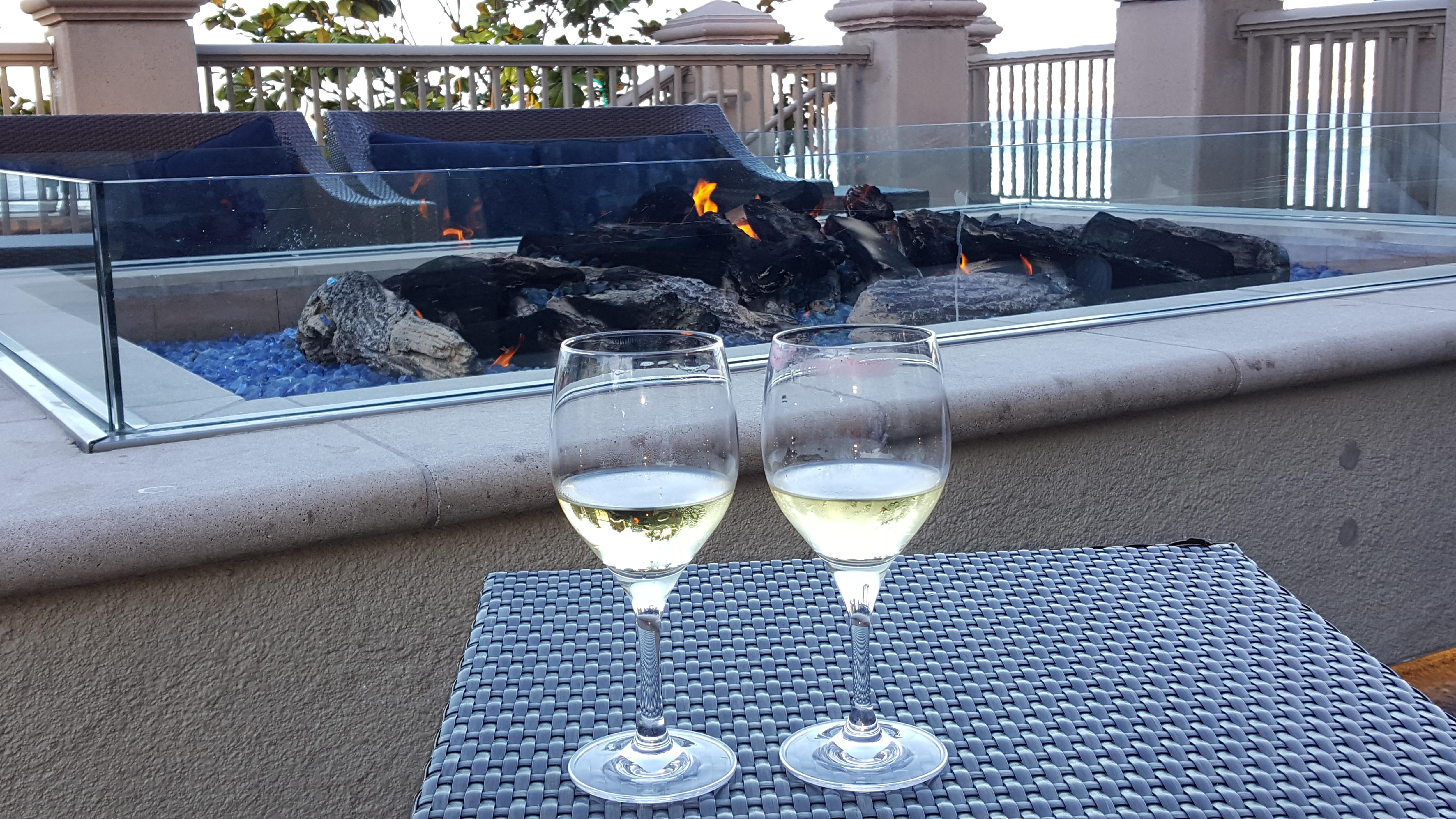 Wine and fire on patio