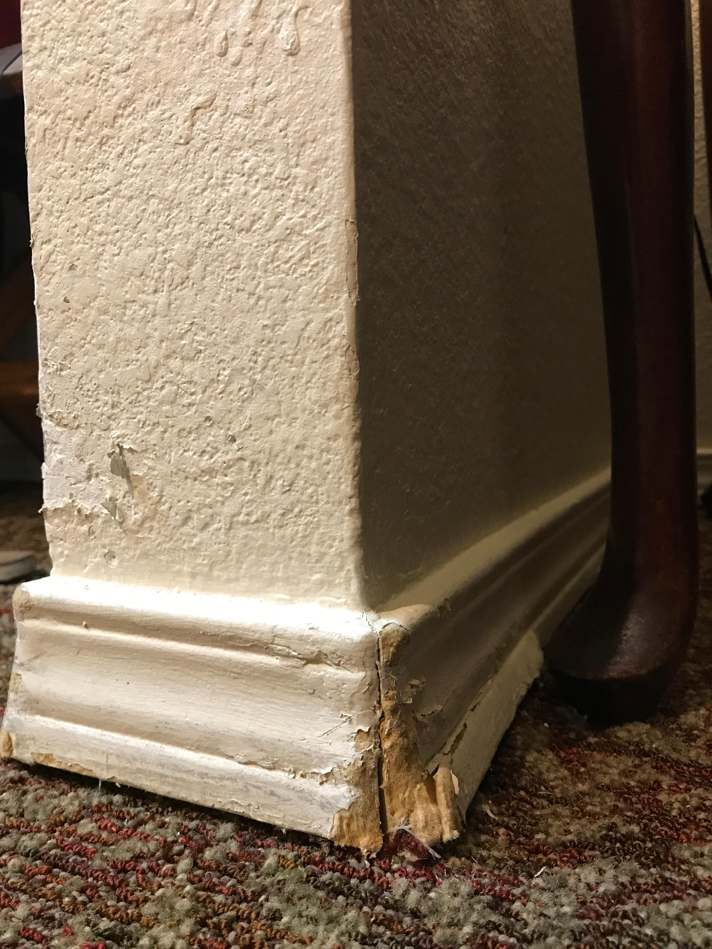 Busted baseboard, dirty walls