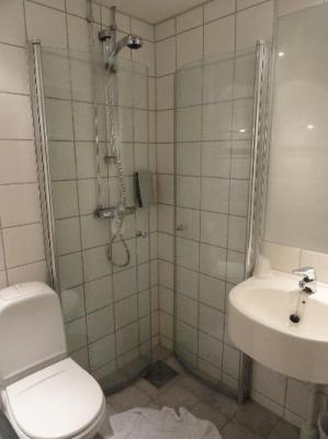 The bathroom was small but functional. Very unique shower.