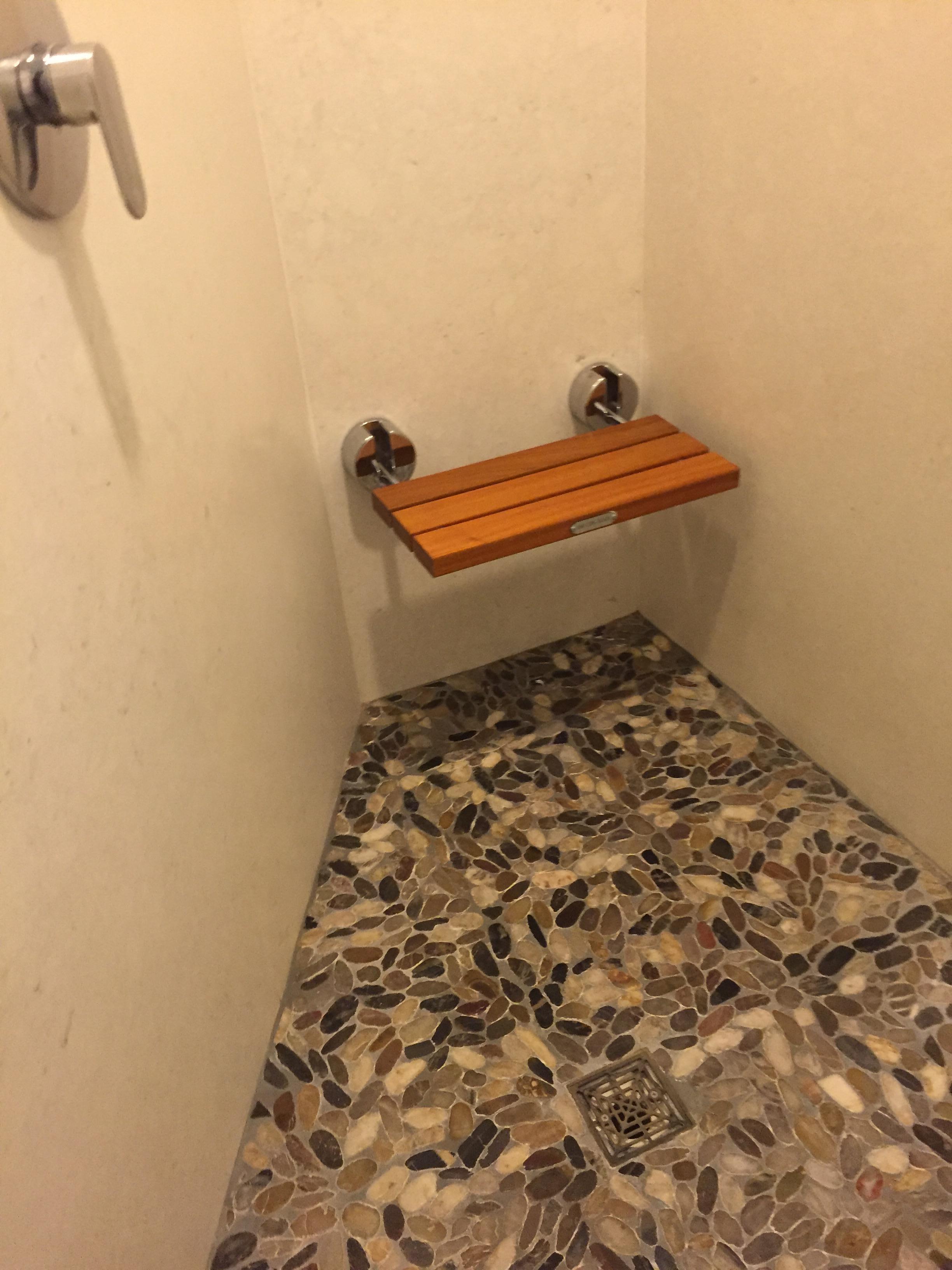 Pebble floor shower w teak bench