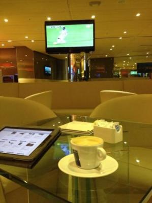 Having coffee and watching a soccer game at the restaurant