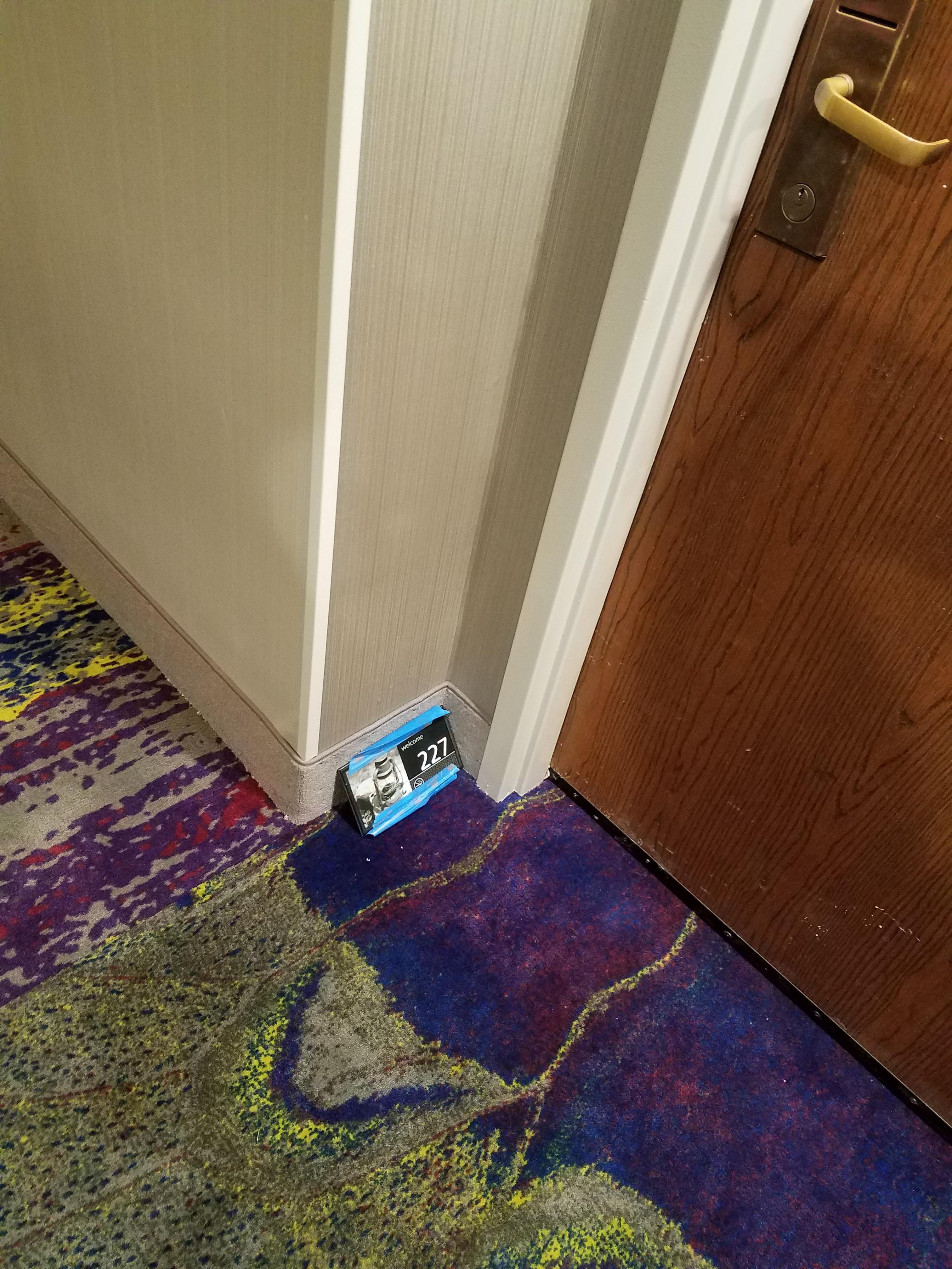 Room numbers on the floor by the door
