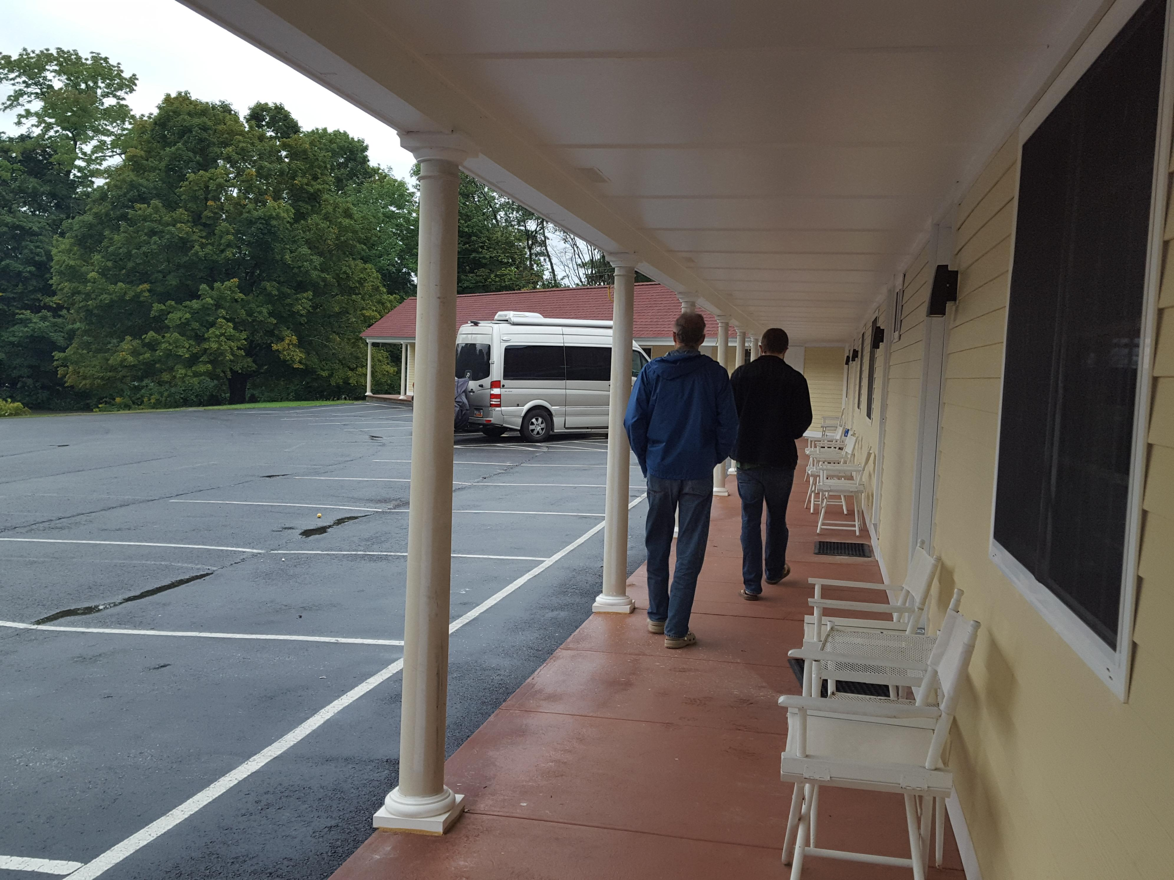Each room has chairs and tables outside and has a covered walkway to the lobby