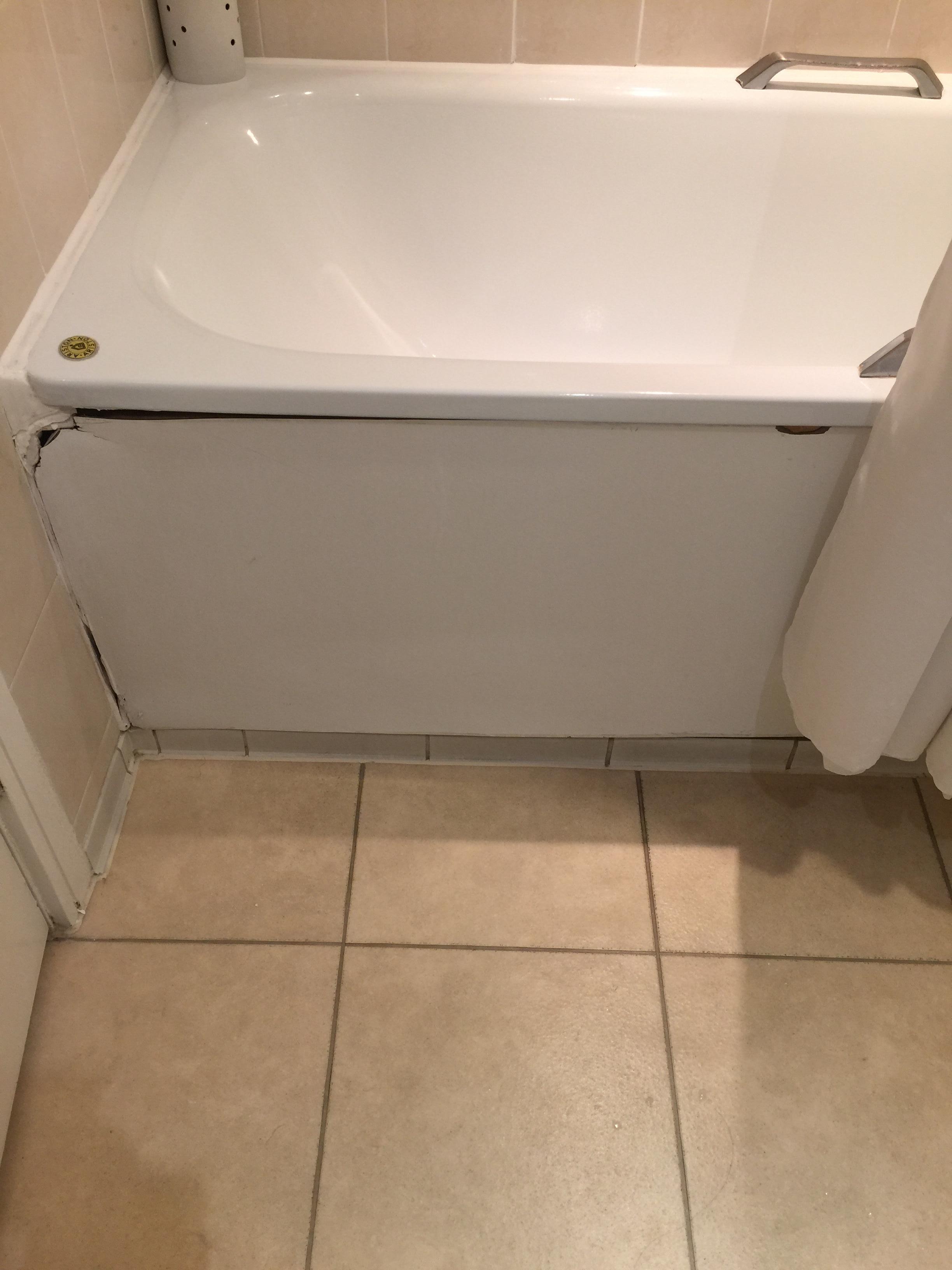 broken bathtub wall