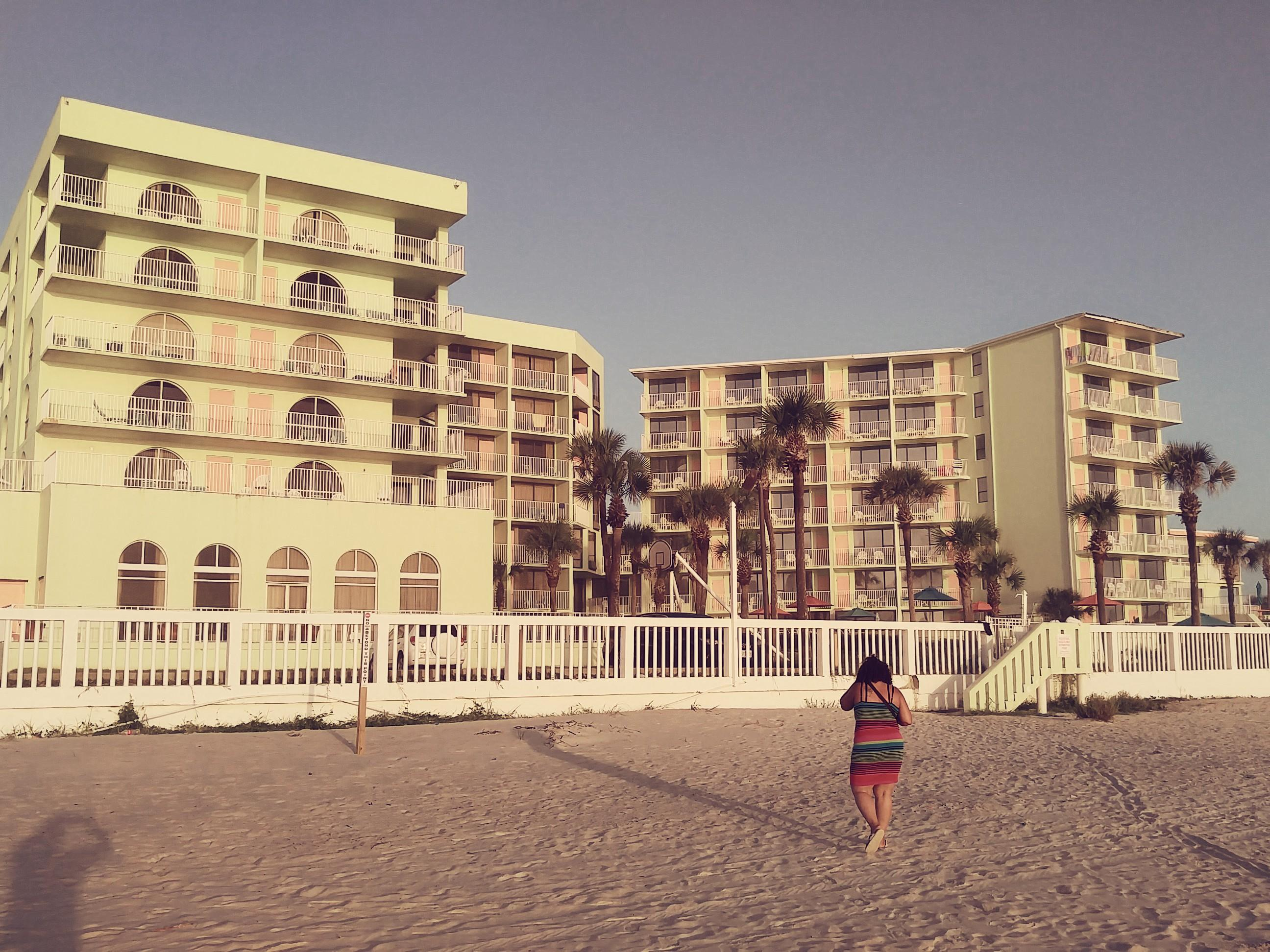 My girl and the hotel from the beach